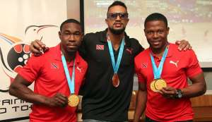 In this file photo, TT cyclists Keron Bramble, from left, Njisane Phillip and Nicholas Paul pose with their 2019 Pan American Games medals at the TT Olympic House in Port of Spain, on Aug 7. The trioare in search of gold tonight at the Elite Pan American Cycling Championships, in Bolivia. PHOTO BY SUREASH CHOLAI